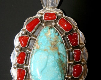 Native American (Navaho) sterling silver, turquoise and red coral pendant, signed B.P.