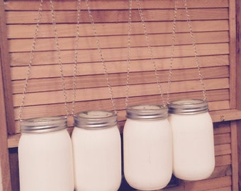 Hanging mason jars/tealight candle holders. This is a set of 4.