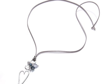 Heart charm pendant necklace with pretty accent beads on long light grey faux suede cord. Available in two colours.