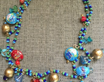 "24"" bead/chain necklace with a plethora of vintage findings"