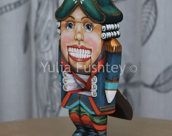 Collectible wooden toy Nutcracker. Hand painted on wood. The author's work. There are moving parts. 6,5 inches