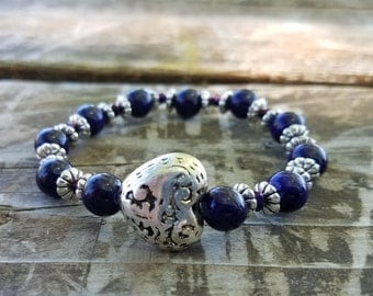 Dark purple and silver beaded bracelet with a heart charm