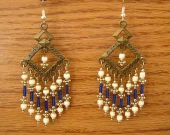 "Chandelier Earrings, brass with blue glass, bone and silver beads, 3 1/4"" long"