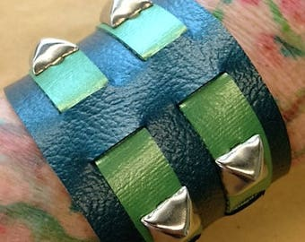 Sale!! Teal & frosted greem vinyl cuff with pyramid studs.