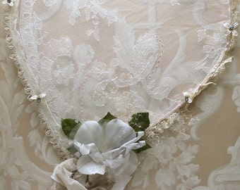 Lace heart made with vintage lace, millinery flowers, and cameo locket
