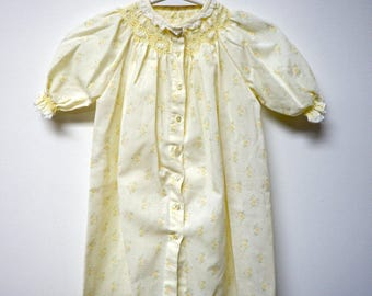 floral print  . light yellow . hand smocked dress . fits like 12 mos