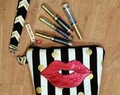 LipSense distributors wrist-let bag, gold,  black,  strips, pok a dots,  holds  25 lipsticks & additional supplies.