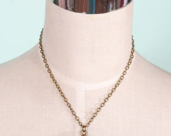 Tiki Time Cameo Necklace in antique brass