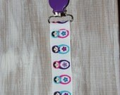 Baby girl purple russian dolls suspender binky clip
