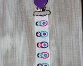 Baby girl purple russian dolls suspender binky clip