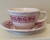 "Red Shenango China Coffee Cup and 5.5 "" Saucer. B 7~39"