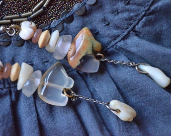 Sentient Beings. Bohemian earrings in earthy colors with native american carved bear beads, quartz, wood and shells.