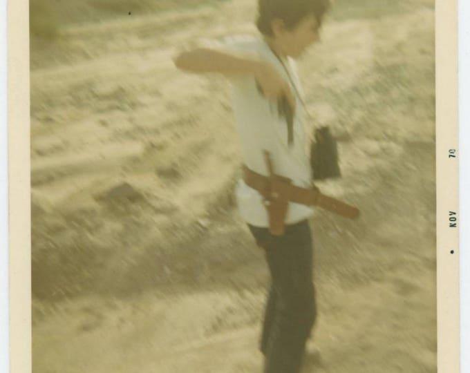 Vintage Snapshot Photo: Boy with Binoculars Draws Pistol, 1970 (75576)