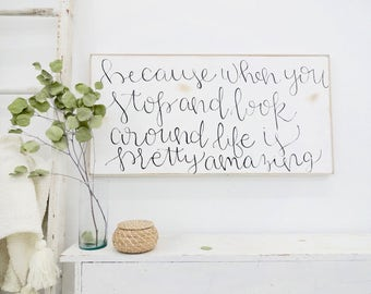 because when you stop and look around, life is pretty amazing black and white rustic wood sign