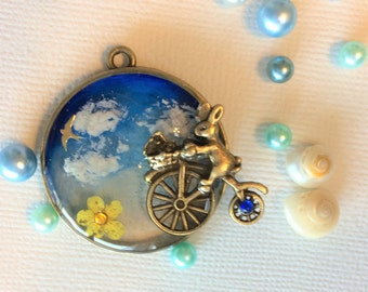 Cycling in the sky bunny pendant top