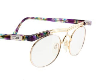 Cazal NOS mod. 251 super cool golden - silver - rainbow avant garde eyeglasses frames made in West Germany in the 1980s.