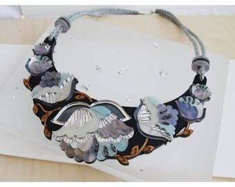 Nouveau Flower Statement Bib Necklace: Mother-of-Pearl. Laser Cut Acrylic Perspex. Marbled Floral Deco Retro Cord. Silver Blue Iridescent