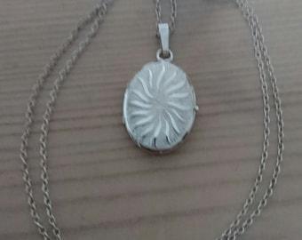 Vintage oval starburst design sterling silver locket and chain