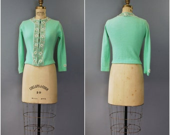 1950's minty green beaded cardigan • small