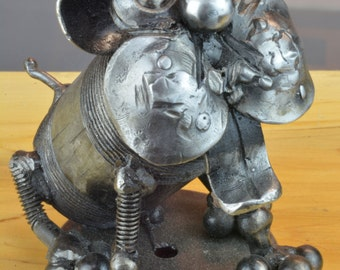 Small sculpture of a pretty little dog named '' Sit Boy 'made entirely from recycled metal materials