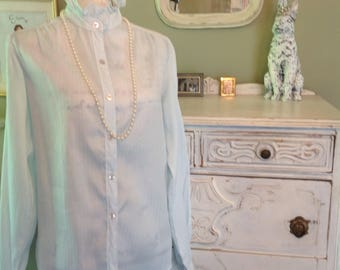 Pale blue Victorian blouse with high collar.....button front.....long sleeves