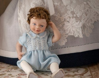 Child in articulated porcelain, blue little bloomers dressed  1:12 scale (dollhouse). OOAK