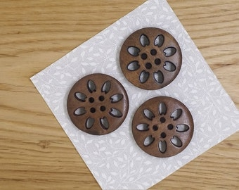 Wooden button, dark brown colour with sun / flower design, pack of 6