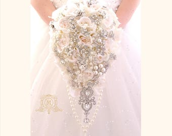 Off white, ivory, touch of pink BROOCH BOUQUET. Silver jeweled silk roses flowers teardrop cascading broach bouquet. Pearls bling wedding