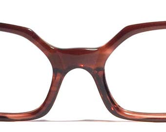 Vintage eyewear. Octagon shape. Tortoise shell color. Sweet rhinestones on front and sides! Made in a USA 1960's. Excellent condition! Hip!
