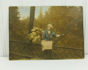 Young Woman on Bridge Rail Waving Large Maple Leaves 1920s Tinted Found Photograph