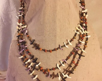 Spectacular Four Strand Vintage Zuni Fetish Necklace with Superb Earth Tone Color Matching of Coral, Jet and Various Shells.