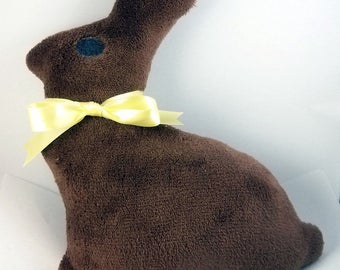 "Cuddly soft stuffed chocolate bunny w/ satin ribbon. Perfect for Easter basket. 12"" tall. Brown or pink. Personalization available"