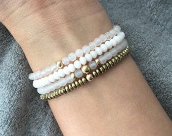 QUINSCO - Four Piece White and Gold Bracelet Stack