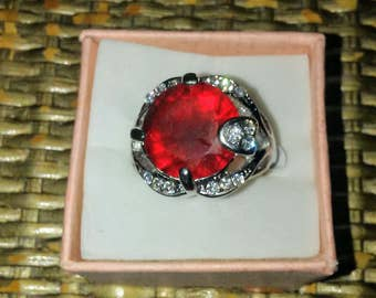 Size Eight Sterling Silver Ring With Red Main Stone and CZ Accent Stones