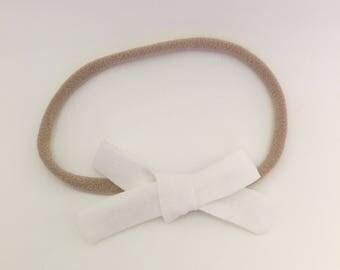 White linen mini school girl bow
