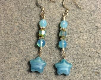Opaque turquoise blue Czech glass star bead dangle earrings adorned with turquoise blue Czech glass beads.