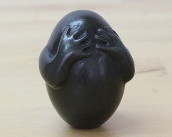 Nothing to Hide - brass egg sculpture, black patina, surreal sculpture
