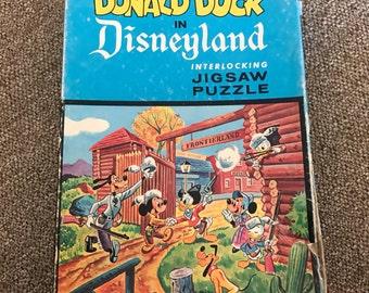 Vintage Walt Disney's Donald Duck in Disneyland western Frontierland Jigsaw Puzzle box, Jaymar, 63 pieces