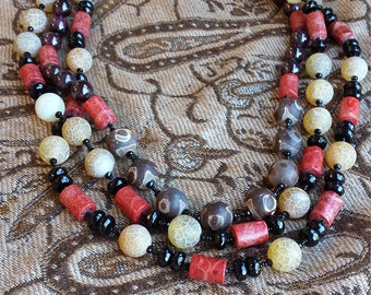 Garnet, black onyx, apple coral and jasper three strand necklace