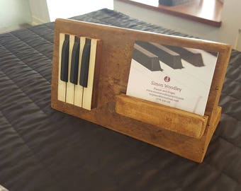 bespoke holder for music piano advertising gift display