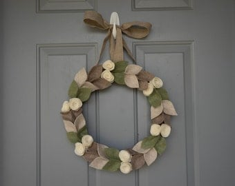 15'' felt and grapevine wreath with cream felt roses and beige, brown and green felt leaves.