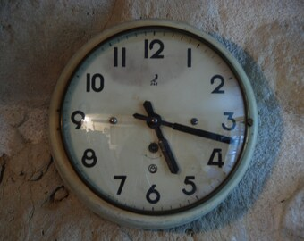 French 1950s kitchen clock, made by Jaz . Retro clock in well worn painted tole or tin. classic 50s style, in working order with key.