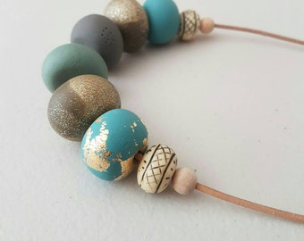 Blue brown green and gold clay beaded necklace/ polymer clay/ blue necklace/ beaded necklace/ leather cord / clay jewellery