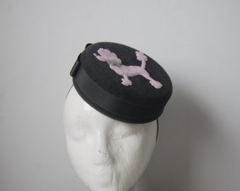 Grey & pink Poodle pillbox hat.