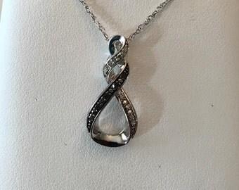 "Vintage sterling silver Black & White Diamond Open Figure 8 Drop pendant, .05 tw, 18"" loose weave chain"