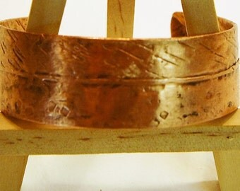 Copper cuff hammered hemmed form folded
