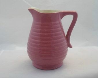 Bright pink jug by Govancraft Pottery of Glasgow, Scotland. 1950s Scottish pottery.