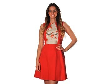 A red dress enhanced with light grey cotton patterned with red and white cherry blossoms