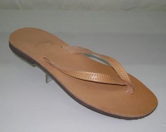 Natural toe flat sandal