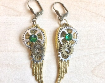 Steampunk with machinery, engines, wings and green crystal earrings